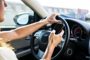 Female driver texting